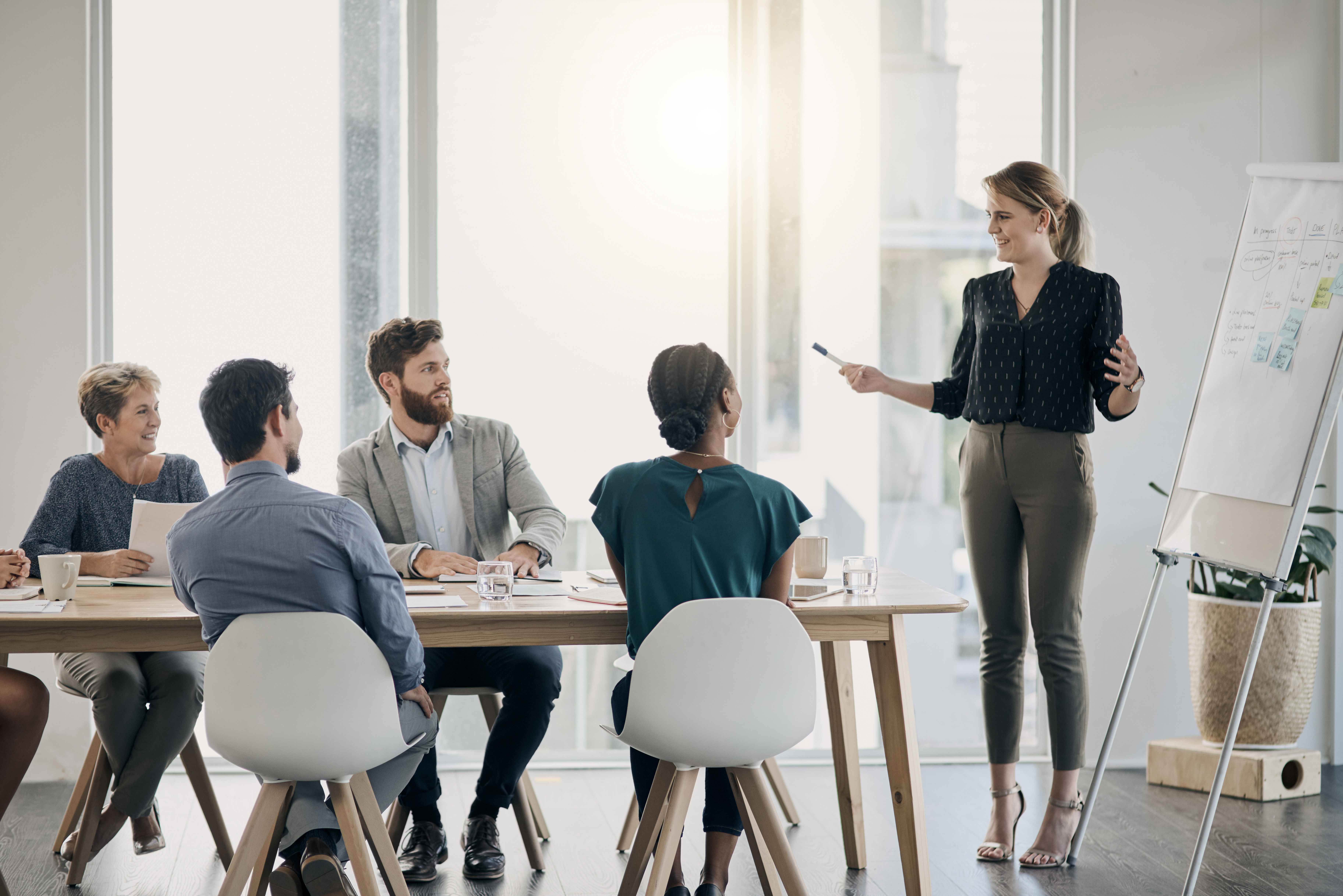 Shot of a young businesswoman giving a presentation to her colleagues in an office